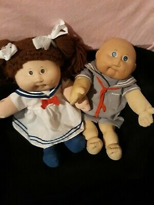 cabbage patch pair she is a 15th anniversary  special doll$ 120 .