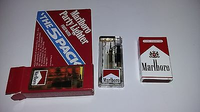 RARE RECALLED Vintage Marlboro Lighter lighted w / matching pack of MATCHES