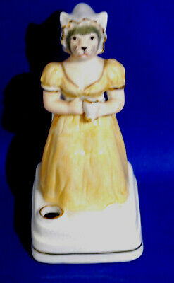 An antique Victorian porcelain figure of a lady cat in Regency dress, pen holder