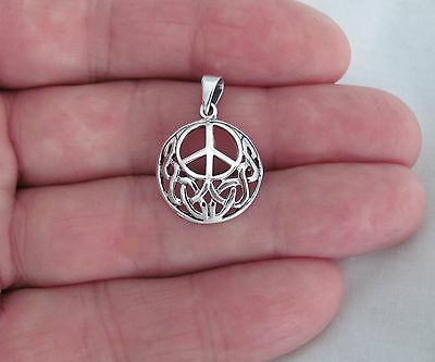 Sterling Silver 18mm Celtic peace sign pendant.