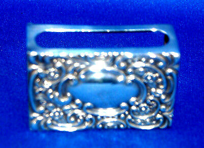 A quality petite antique hallmarked silver (1901) floral repousse matchbox cover