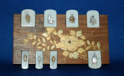 A Victorian Japanese shibayama whist or bridge marker with inlaid insect tabs