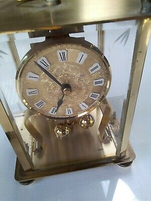 Vintage carriage clock. Made in Germany. Brass.Glass Case Skeleton