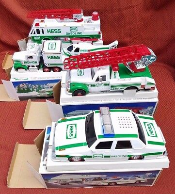 Hess Toy Trucks Lot of 4, 1993 - 1996 New Old Stock w/ boxes
