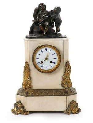 A French white marble, gilt and patinated bronze figural mantel clock, 19th C