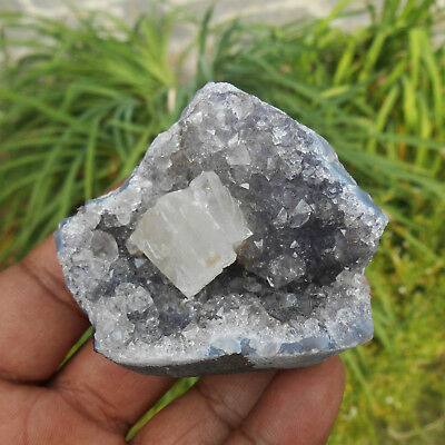 Calcite Crystal On Sparkling Amethyst Geode Section. Mineral Specimen. India.