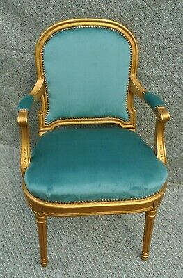 A FRENCH 19th CENTURY UPHOLSTERED LOUIS XVI ARMCHAIR