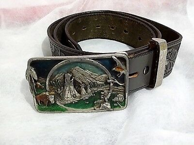 VINTAGE 1983 BUCKLE SISKIYOU BUCKLE CO INC WILLIAMS OREGON  and  Leather BELT