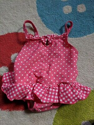 baby girls swimsuit 6-9 months with internal rubber pants.