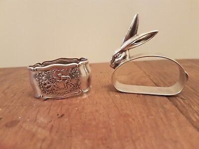 A Stunning pair of Silver Plate Napkin Rings one Scene and Rabbits Head