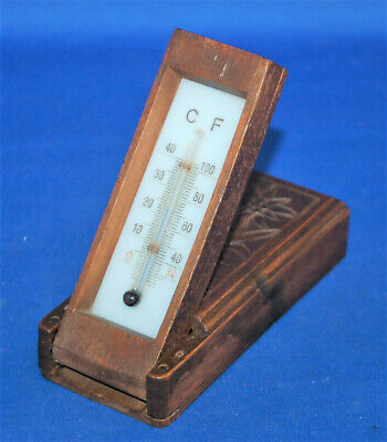 An antique cased  travelling thermometer, carved wooden, Swiss or Black Forest