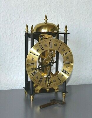 Vintage skeleton clock. Brass. Striking. Running, keeping time. Key included.