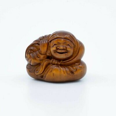 Japanese Netsuke - 19th Century Smiling Peasant Wrapped in a Robe