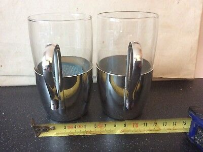 """Pair of Pyrex glass tumblers in silver plate holders. 4.5"""" high 2.5"""" diam"""