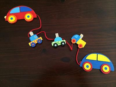 Hanging Wooden cars with clips to display childs art work