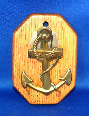 An antique Victorian brass anchor paper clip or letter clip, oak base, nautical