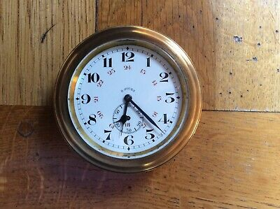 SUPERB ANTIQUE  OCTO   8 DAY CLOCK.Good time keeper comes complete with holder.