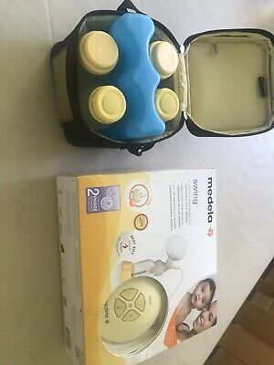 Medela Swing Single Electric 2 Phase Breast Pump with bottles and calma
