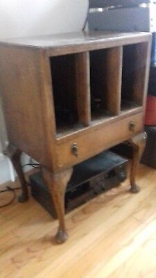Antique wood 78 inch record cabinet with draw