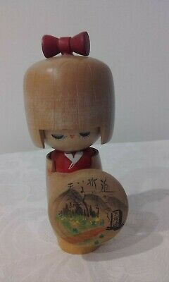 Vintage Japanese Kokeshi wooden doll hand painted stamped on base
