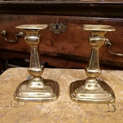 A Pair Of Late Georgian Brass Candlesticks With Separate Sconces