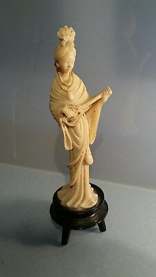 Chinese figure of achinese lady playing musical instrument on stand