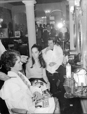 Oona and Victoria Chaplin at the hairdresser. - 8x10 photo