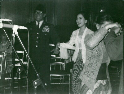 Dewi Sukarno dancing with a man. - 8x10 photo