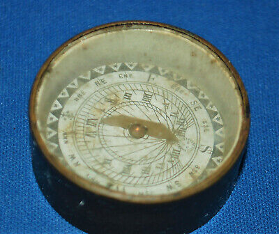An attractive antique Victorian brass pocket compass sundial, floating dial