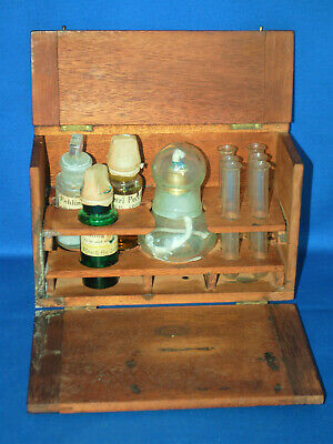 An antique apothecary re-agent cabinet with original contents, Allen and Hanbury