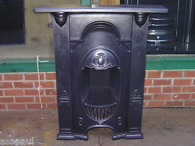 Arts and Crafts tall cast iron combination fireplace.