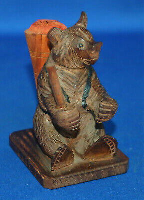 A well carved antique Victorian Black Forest bear figure pin cushion, sewing
