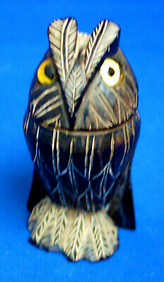 An antique Victorian owl figure thimble holder, glass eyes, well carved