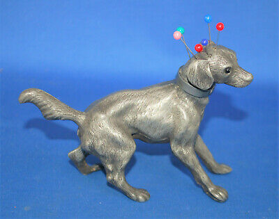 An antique hound dog dress or hatpin holder, peperette, pewter, glass eyes