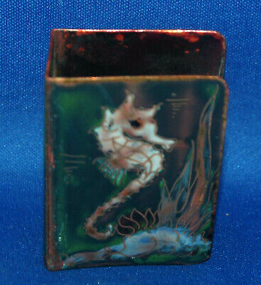 An unusual antique guilloche enamelled brass seahorse matchbox cover or holder