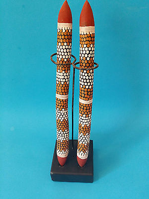 Vintage Aboriginal hand painted clap sticks includes the display stand