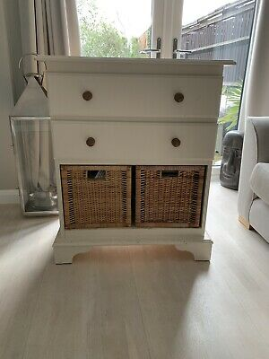 pine chest of drawers, with wicker baskets