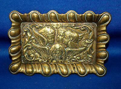 An antique Art Nouveau Victorian brass trinket tray with repousse Reynolds angel