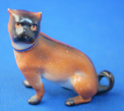A lovely antique porcelain sitting pug dog figure, early Victorian, small size