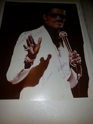 an autographed picture of sammy davis jr performing