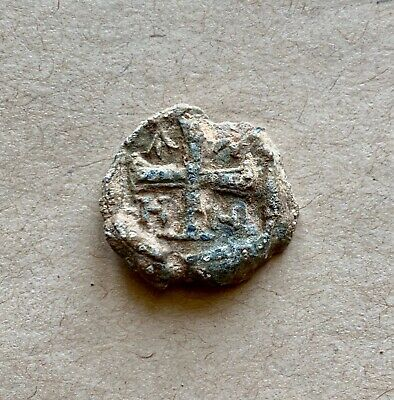 BYZANTINE LEAD SEAL/ BYZANZ SIEGEL WITH CROSSES AND LETTERS (6th cent.)