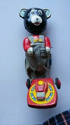 vintage TIN TOY black bear pushing lawnmower with key & looks complete, works?