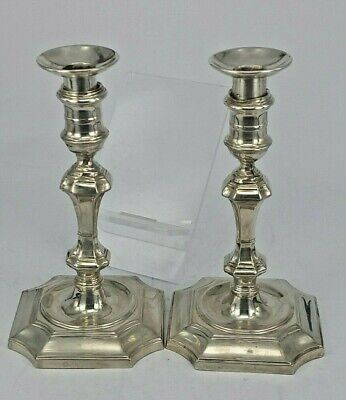 A pair of Edwardian taper candlesticks made in Georgian style