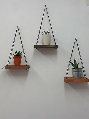 Rustic floating wall shelf with thin black rope