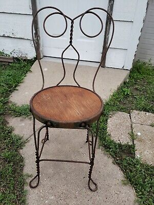 Wrought iron Ice cream Parlor Chair. Twisted wrought iron chair with wood seat.