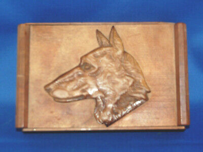 A Black Forest or Swiss carved wooden box, repousse carved Alsatian dog head