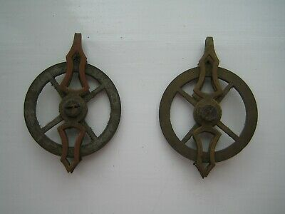 A  Pair of Fancy Vienna Clock Pulleys