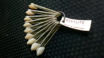A Set of 9, Acrylic Resin Denture Teeth by Acrylite. colour matching tool
