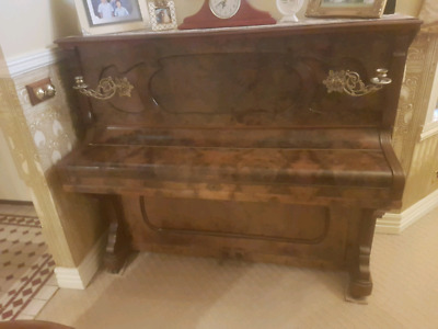 Antique Upright Piano with brass sconce