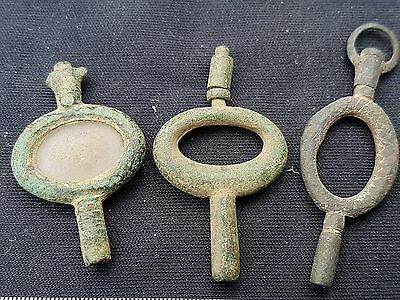 Lovely trio of early watch fob winders L12q
